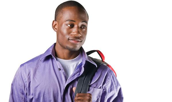 Photo of a student carrying a backpack.