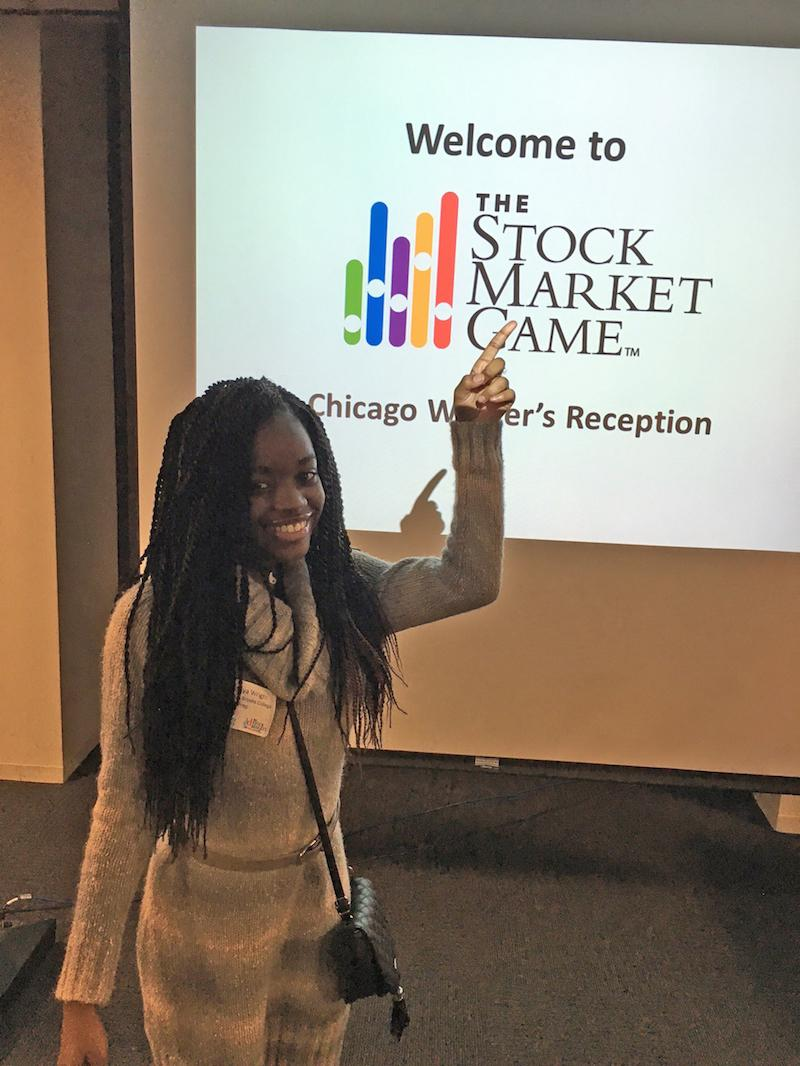 Photo of Dartonya Wright in front of slideshow at Board Options Exchange.