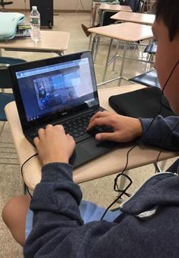 Student with Chromebook.