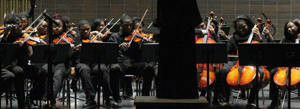 Photo of orchestra students playing.